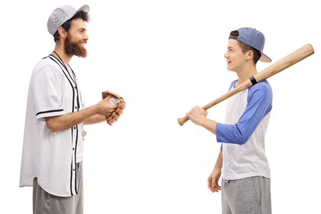 Profile shot of a baseball coach and a teenager with a baseball bat isolated on white background