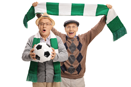 Excited elderly football fans cheering isolated on white background Stock Photo