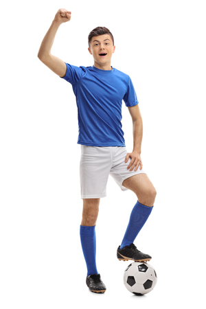 Full length portrait of a teenage football player gesturing happiness isolated on white background