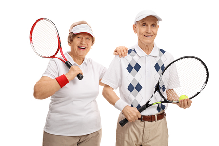 70s tennis: Elderly tennis players looking at the camera and smiling isolated on white background