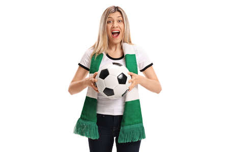 Female soccer fan with a scarf and football cheering isolated on white background