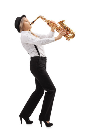 full shot: Full length profile shot of a female jazz musician playing a saxophone isolated on white background Stock Photo