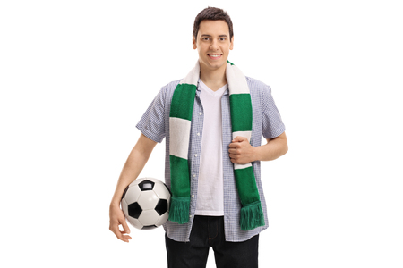 Young soccer fan with a scarf and a football isolated on white background