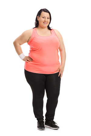 Full length portrait of an overweight woman dressed in sportswear isolated on white background