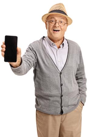 上級カメラに携帯電話を見せて、白い背景で隔離の笑顔