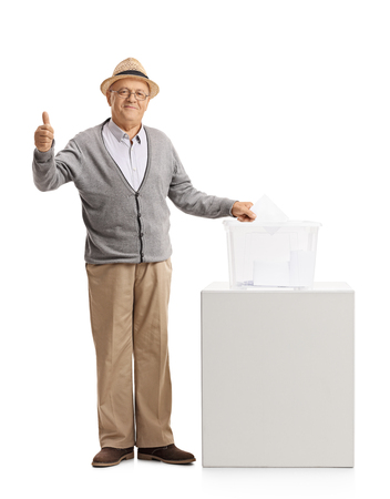 Full length portrait of a mature man voting and making a thumb up gesture isolated on white background Stock Photo