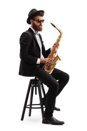 jazzy: Jazz musician with a saxophone sitting on a chair isolated on white background Stock Photo