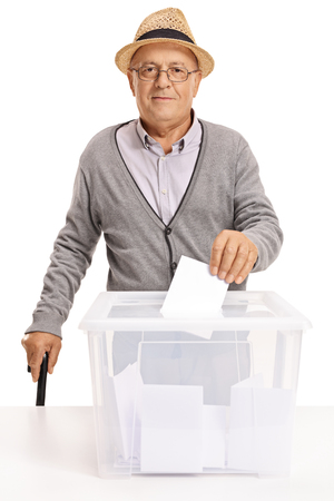 Senior voting and looking at the camera isolated on white background Stock Photo
