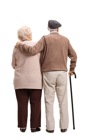 Full length rear view shot of an elderly couple isolated on white background