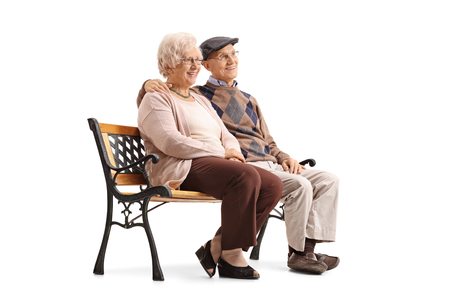 isolated man: Senior couple sitting on a bench and looking away isolated on white background