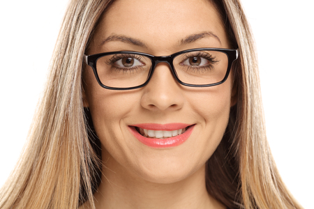 Close-up of a woman wearing eyeglasses and smiling isolated on white background Stock Photo