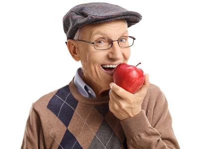 Senior having an apple isolated on white background Stockfoto