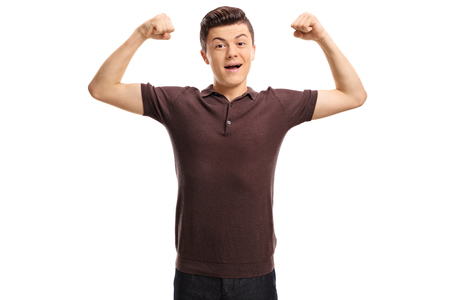Teenager flexing his muscles and looking at the camera isolated on white background photo