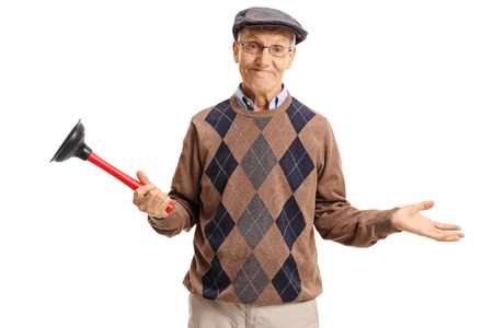 Disappointed senior holding a plunger isolated on white background