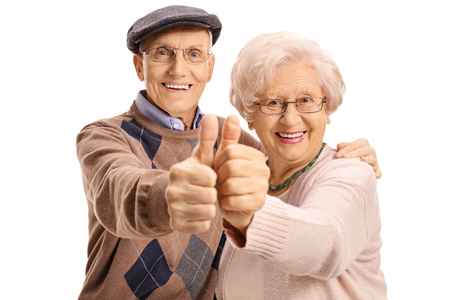 Cheerful mature couple making a thumbs up gesture isolated on white background
