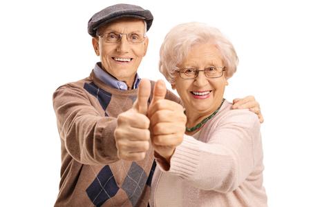 Fröhlich Älteres Ehepaar macht einen Daumen hoch Geste isoliert auf weißem Hintergrund Standard-Bild - 80729854