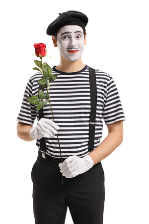 Mime holding a red rose and looking at the camera isolated on white background Stock Photo - 81117182