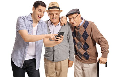 Young guy showing something on a phone to two elderly men isolated on white background Stock Photo