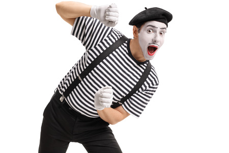 Mime behind an imaginary panel isolated on white background Stock Photo
