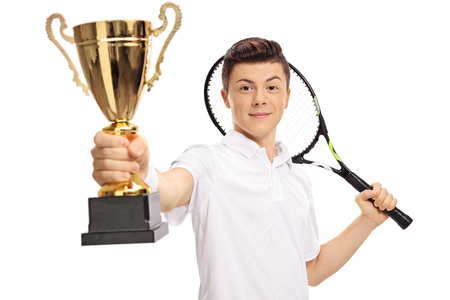 Teenage tennis player holding a golden trophy isolated on white background Stock Photo
