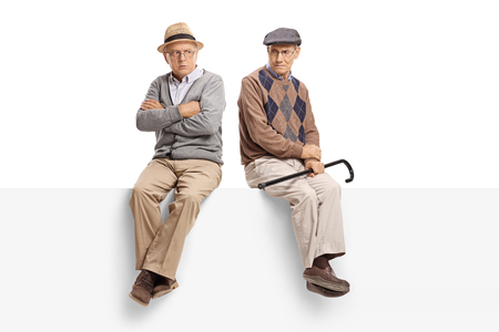 spat: Angry seniors sitting on a panel isolated on white background