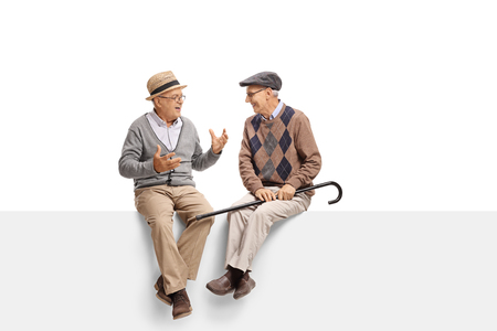 immersed: Seniors sitting on a panel and talking isolated on white background