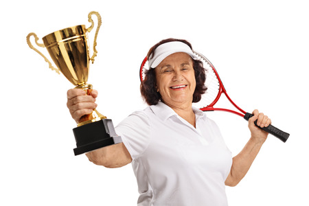 70s tennis: Elderly tennis player with a golden trophy and a racket isolated on white background Stock Photo