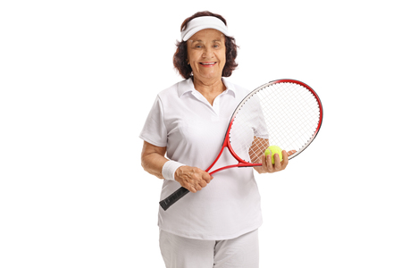 70s tennis: Elderly tennis player with a racket and a ball isolated on white background