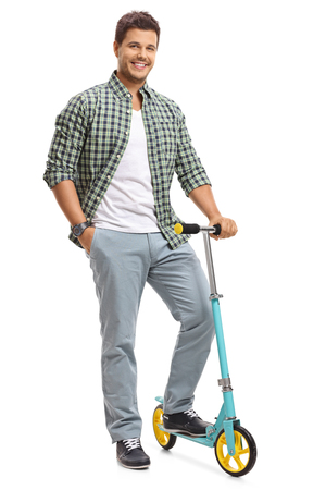 Full length portrait of a young guy with a scooter isolated on white background photo