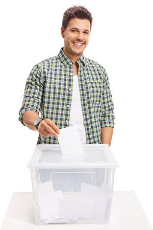 Male voter casting a vote into a ballot box isolated on white background photo