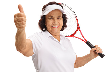 70s tennis: Elderly tennis player making a thumb up gesture isolated on white background