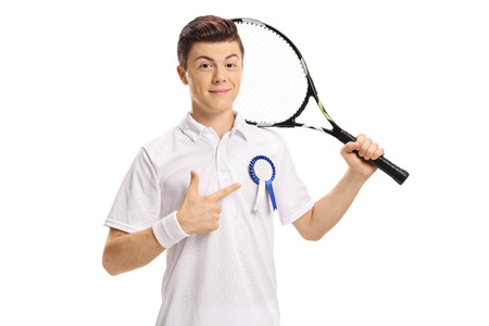 Teenage tennis player with an award ribbon pointing isolated on white background