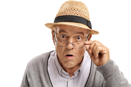 unanticipated: Surprised mature man looking at the camera isolated on white background
