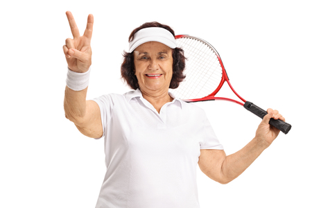 70s tennis: Elderly tennis player making a victory sign isolated on white background Stock Photo