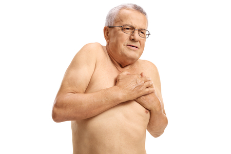 Shirtless mature man experiencing chest pain isolated on white background