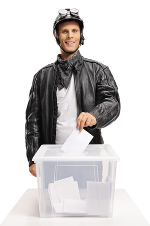 Biker voting and looking at the camera isolated on white background