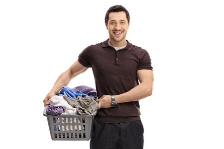 Guy with a laundry basket full of clothes isolated on white background
