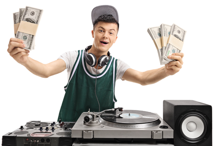 Cheerful teenage DJ with bundles of money isolated on white background Stock Photo