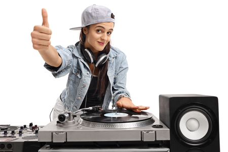 audio mixer: Female DJ making a thumb up sign isolated on white background