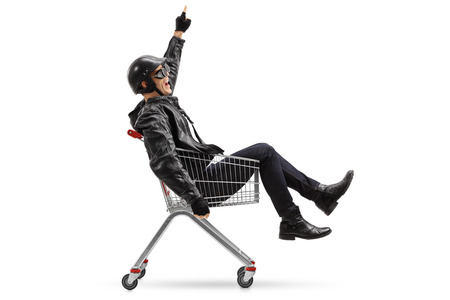 pushcart: Cheerful biker riding in a shopping cart isolated on white background