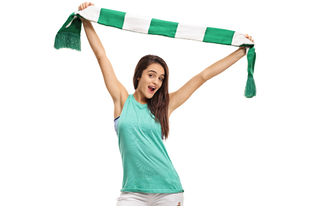 Female sports fan cheering with a scarf isolated on white background