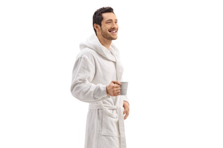 Guy in a bathrobe holding a cup isolated on white background