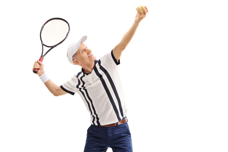 70s tennis: Old tennis player preparing to serve isolated on white background