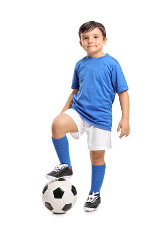 Full length portrait of a little footballer isolated on white background Foto de archivo