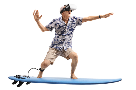 Senior using a VR headset and surfing isolated on white background