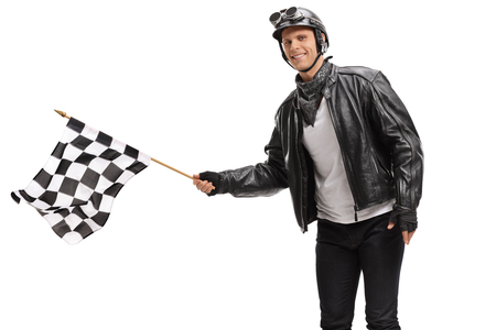 Biker waving a checkered race flag isolated on white background Stock Photo