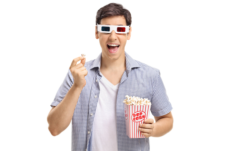 Young man with 3-D glasses having popcorn and laughing isolated on white background