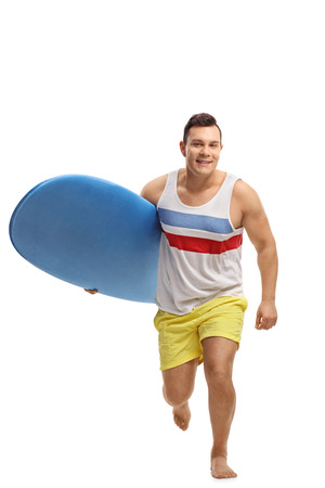 Full length portrait of a young man with a surfboard running towards the camera isolated on white background