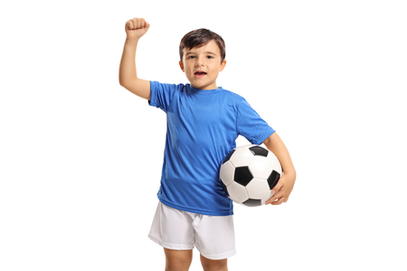 Joyful little footballer gesturing with his hand isolated on white background