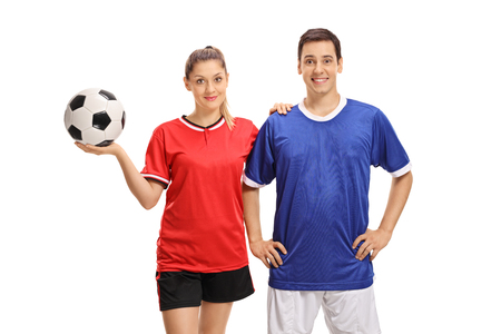 Female and male soccer players looking at the camera and smiling isolated on white background